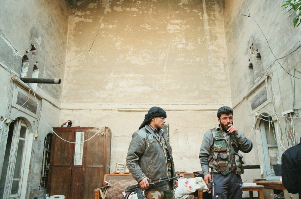 Free Syrian Army fighters prepare for an assault on government forces in the Old City of Aleppo. F100 Portra 400