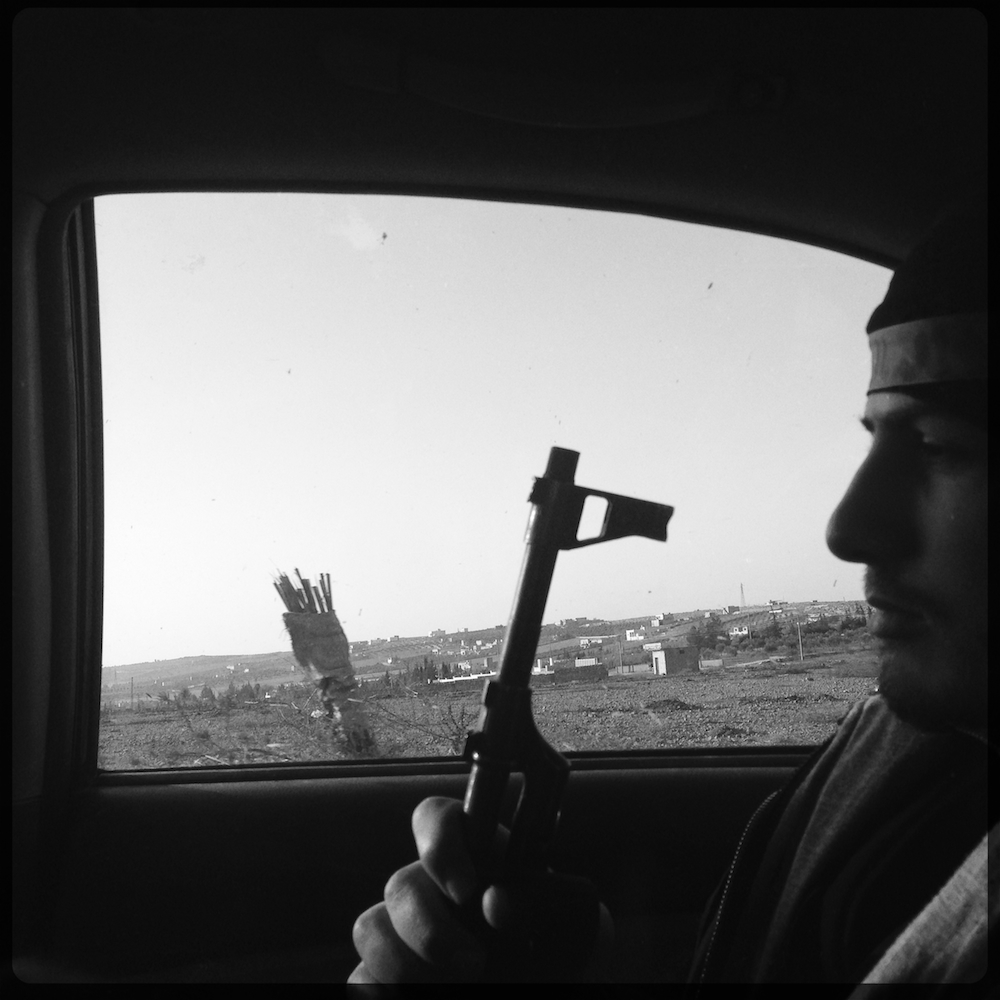 Doctor, 19, on the drive into Aleppo. iPhone Hipstamatic App
