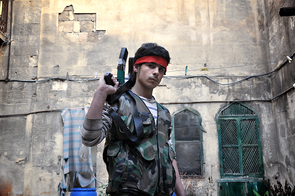 Ali, 18, poses for a photograph at the frontlines of Aleppo. D90